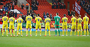 Nottingham Forest players hold a minute of applause to remember those lost in 2015 before the Sky Bet Championship match between Charlton Athletic and Nottingham Forest at The Valley, London, England on 2 January 2016. Photo by Andy Walter.