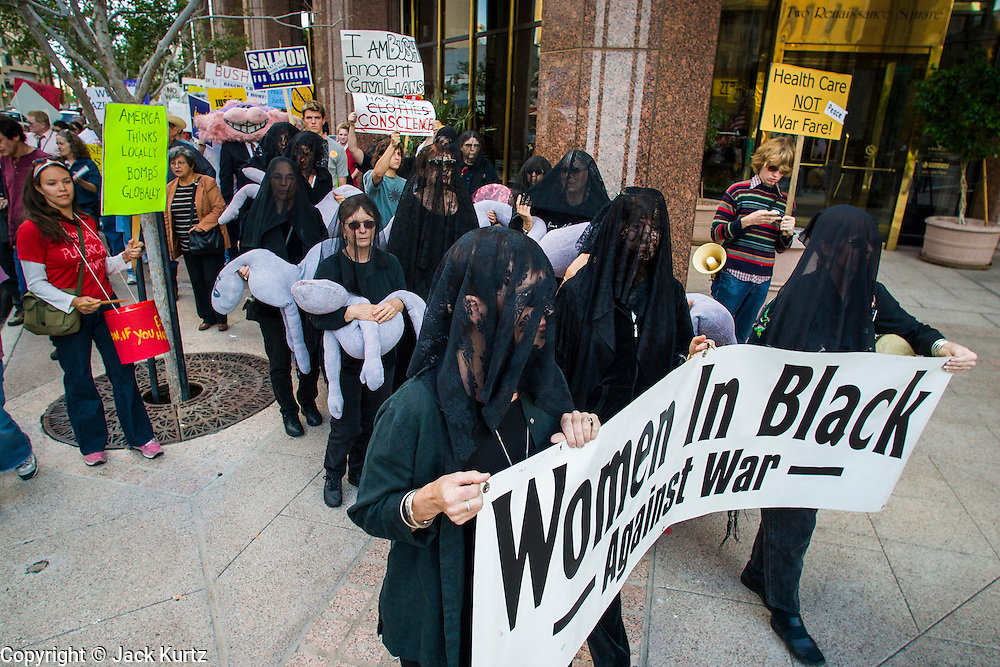 27 OCTOBER 2002 - PHOENIX, AZ: Hundreds of people, including many from the anti-war grou Women in Black, march through downtown Phoenix to protest against the impending war in Iraq.       PHOTO BY JACK KURTZ