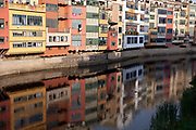 Girona houses reflecting in the water of the river Onyar Spain