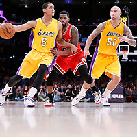 29 January 2015: Los Angeles Lakers guard Jordan Clarkson (6) drives past Chicago Bulls guard Aaron Brooks (0) on a screen set by Los Angeles Lakers center Robert Sacre (50) during the Los Angeles Lakers 123-118 2OT victory over the Chicago Bulls, at the Staples Center, Los Angeles, California, USA.