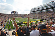 September 19, 2009: Iowa fans cheer as the team takes the field before the Iowa Hawkeyes' 27-17 win over the Arizona Wildcats at Kinnick Stadium in Iowa City, Iowa on September 19, 2009.