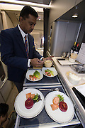 Airbus A380 first commercial flight - Singapore Airlines SQ 380 Singapore-Sydney on October 25, 2007. Chief Steward preparing a business class meal.