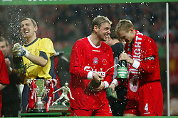 CARDIFF, WALES - Sunday, March 2, 2003: Liverpool's Jerzy Dudek (l) and Stephane Henchoz (r) celebrate with champagne after beating Manchester United 2-0 to win the Football League Cup at the Millennium Stadium. (Pic by David Rawcliffe/Propaganda)