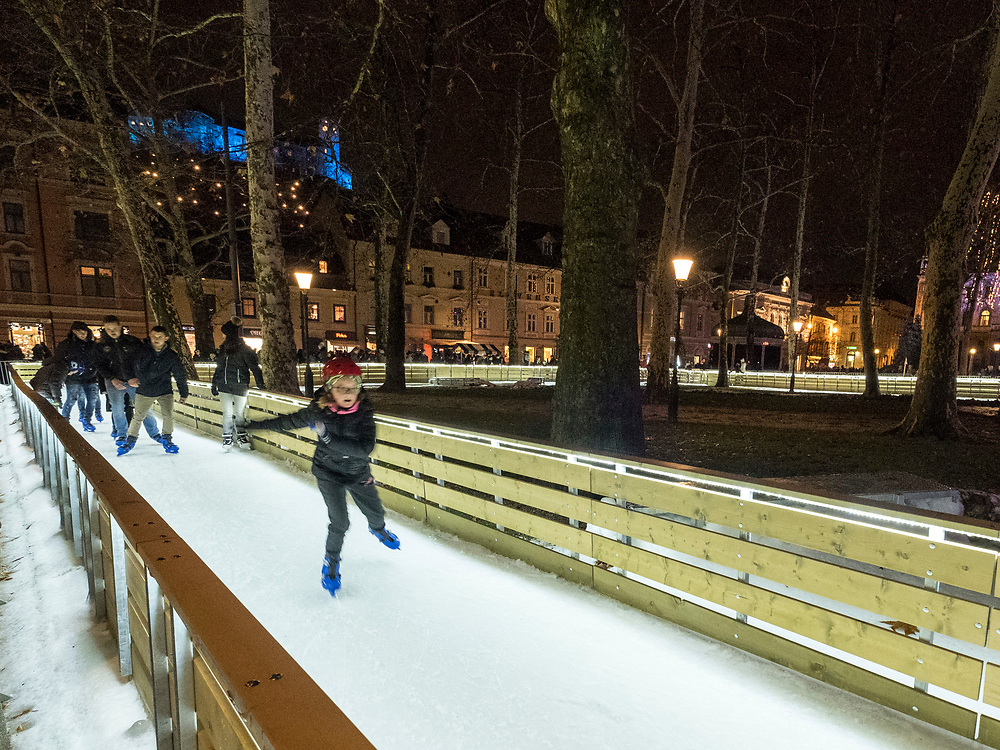 LJUBLJANA, SLOVENIA - DECEMBER 02:  A child ice skates on the Christmas Ice Fantasy in the city centre on December 2, 2017 in Ljubljana, Slovenia. The traditional Christmas market and lights will stay until 1st week of January 2018.  (Photo by Marco Secchi/Getty Images)
