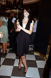 KATIE TURNER at a party to celebrate the opening of PPQ Mayfair at 47 Conduit Street, London W1 on 18th September 2006.<br />