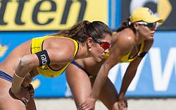 01-08-2014 AUT: FIVB Grandslam Volleybal, Klagenfurt<br /> Brasilian Players Juliana Felisberta Silva, Maria Elisa Antonelli at the women's Quaterfinal Match of the A1 Beachvolleyball Grand Slam<br /> ***NETHERLANDS ONLY***