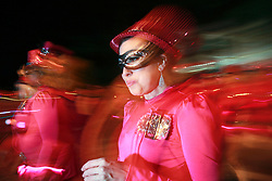12 Feb 2015. New Orleans, Louisiana.<br /> Mardi Gras. The Camel Toe Lady Steppers make their way along Magazine Street  with the The Krewe of Muses. <br /> Photo; Charlie Varley/varleypix.com