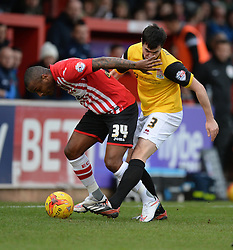 Northampton's Evan Horwood tackles Exeter City's Clinton Morrison - Photo mandatory by-line: Alex James/JMP - Mobile: 07966 386802 - 10/01/2015 - SPORT - football - Exeter - St James Park - Exeter City v Northampton - Sky Bet League Two