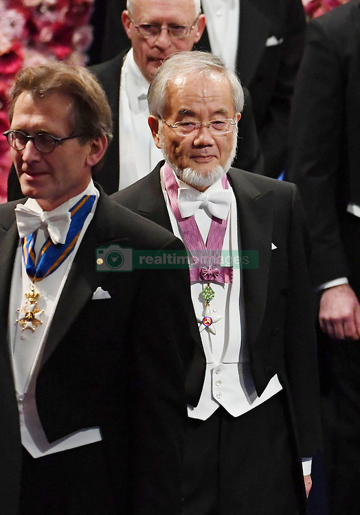 "Nobelpreisverleihung 2016 in der Konzerthalle in Stockholm / 101216 ***Japanese scientist Yoshinori Ohsumi (C) arrives at a concert hall in Stockholm to attend the Nobel Prize Award Ceremony on Dec. 10, 2016. Ohsumi was awarded the Nobel prize in physiology or medicine for elucidating ""autophagy,"" an intracellular process that degrades and recycles proteins."