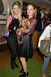 Left to right, ASHLEY JAMES and her dog Snoop and ROSIE FORTESCUE and her dog Noodles at A Date With Your Dog At George in aid of the Dogs Trust held at George, 87-88 Mount Street, London on 9th September 2014.
