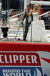 © Licensed to London News Pictures. 23/08/2013. Newly weds at St Catherine's Dock pose for photos on board the GB team's yacht which is taking part in the round the world clipper race credit : Rob Powell/LNP