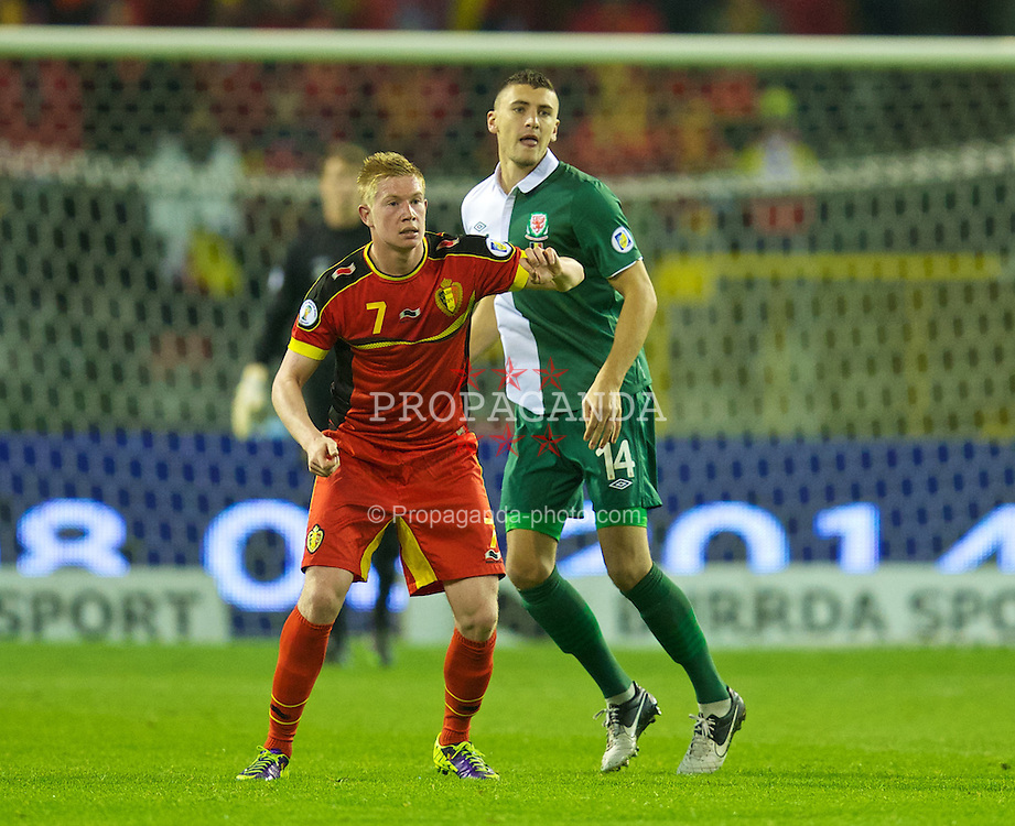 BRUSSELS, BELGIUM - Tuesday, October 15, 2013: Wales' James Wilson in action against Belgium's Kevin De Bruyne during the 2014 FIFA World Cup Brazil Qualifying Group A match at the Koning Boudewijnstadion. (Pic by David Rawcliffe/Propaganda)