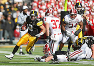 October 31, 2009: Iowa running back Brandon Wegher (3) tries to get around Indiana safety Collin Taylor (37) during the first half of the Iowa Hawkeyes' 42-24 win over the Indiana Hoosiers at Kinnick Stadium in Iowa City, Iowa on October 31, 2009.