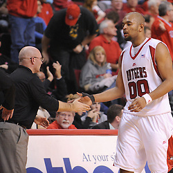Jan 31, 2009; Piscataway, NJ, USA; Rutgers head coach Fred Hill high fives forward Gregory Echenique (00) after scoring a big basket during the second half of Rutgers' 75-56 victory over DePaul in NCAA college basketball at the Louis Brown Athletic Center