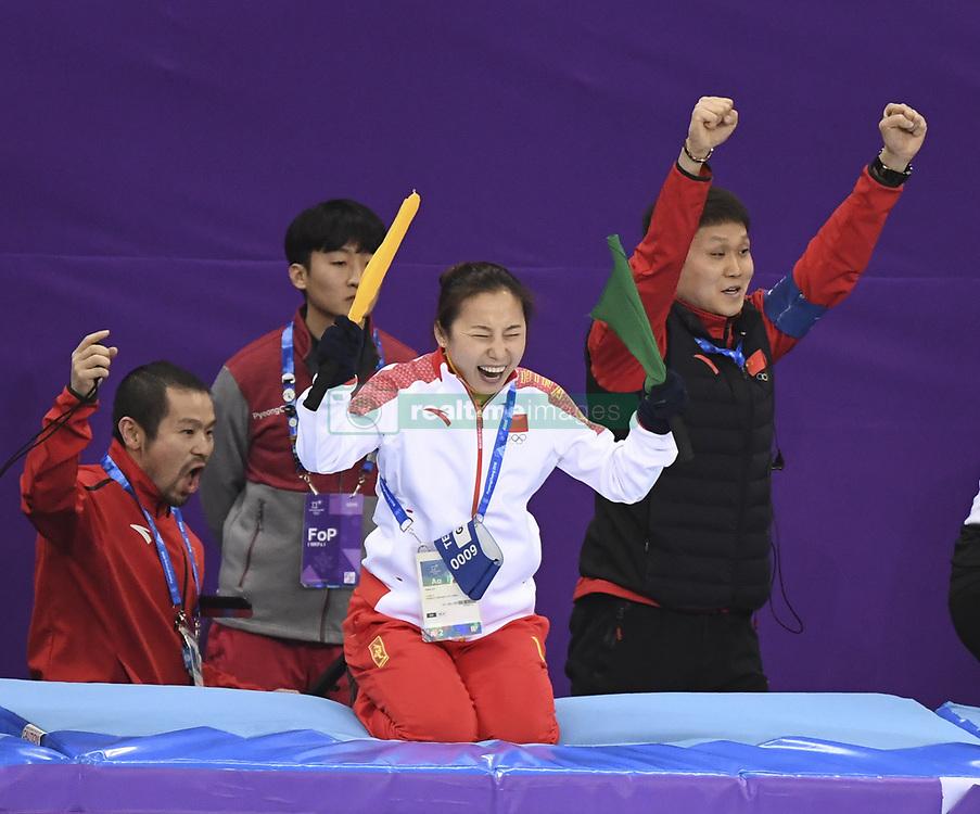 PYEONGCHANG, Feb. 22, 2018  Li Yan (2nd R), head coach of China's short track speed skating team, celebrates after China's Wu Dajing winning men's 500m final of short track speed skating at the 2018 PyeongChang Winter Olympic Games at Gangneung Ice Arena, Gangneung, South Korea, Feb. 22, 2018. Wu Dajing claimed gold medal in a time of 0:39.584 and set new world record. (Credit Image: © Ju Huanzong/Xinhua via ZUMA Wire)