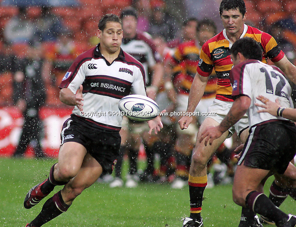 North Harbour's Luke McAlister taking a pass from Rua Tipoki during the Air NZ Cup rugby match between Waikato and North Harbour played at Waikato Stadium, Hamilton, New Zealand on Sunday 1 October  2006. Waikato won 31-15    Photo: Brett O'Callaghan/PHOTOSPORT