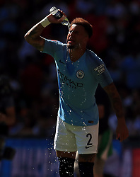 "Manchester City's Kyle Walker cools down with water during the Community Shield match at Wembley Stadium, London. PRESS ASSOCIATION Photo. Picture date: Sunday August 5, 2018. See PA story SOCCER Community Shield. Photo credit should read: Mike Egerton/PA Wire. RESTRICTIONS: EDITORIAL USE ONLY No use with unauthorised audio, video, data, fixture lists, club/league logos or ""live"" services. Online in-match use limited to 75 images, no video emulation. No use in betting, games or single club/league/player publications."