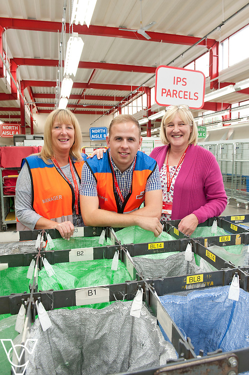 Pictured, from left, manager Cheryl Breed, deputy manager James Wright and Mandy Palmer delivery office manager for Leicester North Delivery Office<br /> <br /> James Wright is a deaf former postman who has worked his way into a management position at Leicester North Delivery Office to become on of, if not the, only deaf person employed in management by Royal Mail.<br /> <br /> Date: September 21, 2015