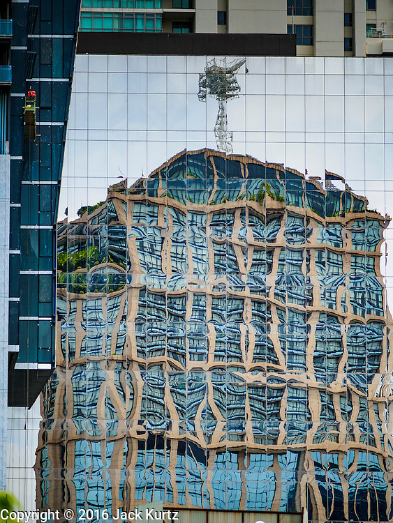 09 SEPTEMBER 2016 - BANGKOK, THAILAND: The Emporium Suites Hotel reflected in an office building across Sukhumvit Road from the hotel and next to EmQuartier, a new high end mall on Sukhumvit.     PHOTO BY JACK KURTZ