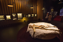 © licensed to London News Pictures. London, UK 05/07/2012. A dummy which have been used in Goldfinger to pose as Shirley Eaton being shown with many Bond items which have been used in the movies in the last 50 years at Designing 007 exhibition at Barbican Centre. Photo credit: Tolga Akmen/LNP