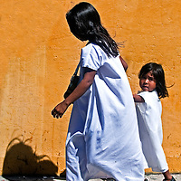 SANTA MARTA , COLOMBIA - DECEMBER 20 2010 : Indians mother and child walks in the street in Santa Marta , Colombia