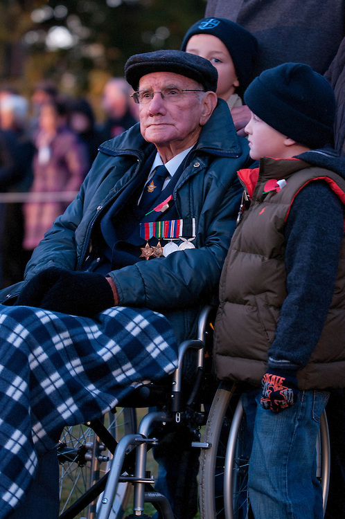 Bob Elson, 89, who served in the Pacific, with his grandsons Hunter, left, seven, and Marcus, six, Elson at the Dawn ANZAC Service, Christchurch, New Zealand, Wednesday April 25, 2012. Credit: SNPA /  David Alexander.