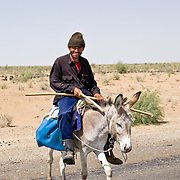 Man on donkey near village outside Bukhara