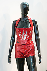 © Licensed to London News Pictures. 26/07/2018. London, UK. Various clothing and shoes worn by by Mel B, Melanie C, Geri Halliwell, Victoria Beckham, Emma Bunton are on display at the Spice Girls exhibition. The interactive exhibition features hundreds of iconic stage, music video and film costumes worn by the popular 90s girl band at Business Design Centre/Photo credit: Ray Tang/LNP