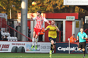 Stevenage FC midfielder Michael Tonge goes for a header against Oxford United forward Ryan Taylor during the Sky Bet League 2 match between Stevenage and Oxford United at the Lamex Stadium, Stevenage, England on 31 October 2015. Photo by Jemma Phillips.