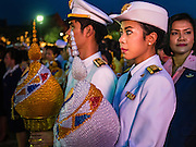 05 DECEMBER 2015 - BANGKOK, THAILAND: Thais wait to make merit by presenting the King's representatives with gifts that represent lotus buds on the King's Birthday on Sanam Luang in Bangkok. Thais marked the 88th birthday of Bhumibol Adulyadej, the King of Thailand,  Saturday. The King was born on December 5, 1927, in Cambridge, Massachusetts. The family was in the United States because his father, Prince Mahidol, was studying Public Health at Harvard University. He has reigned since 1946 and is the world's currently the longest serving monarch in the world and the longest serving monarch in Thai history. Bhumibol, who is in poor health, is revered by the Thai people. His birthday is a national holiday and is also celebrated as Father's Day. He is currently hospitalized in Siriraj Hospital, recovering from a series of health setbacks.    PHOTO BY JACK KURTZ