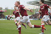 Northampton No 10 Nicky Adams celebrates after scoring the opening goal in the Sky Bet League 2 match between Northampton Town and Bristol Rovers at Sixfields Stadium, Northampton, England on 9 April 2016. Photo by Nigel Cole.