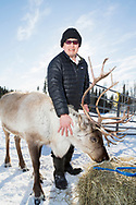 Kenji Yoshikawa with his reindeer at his farm outside Fairbanks, Alaska, USA.