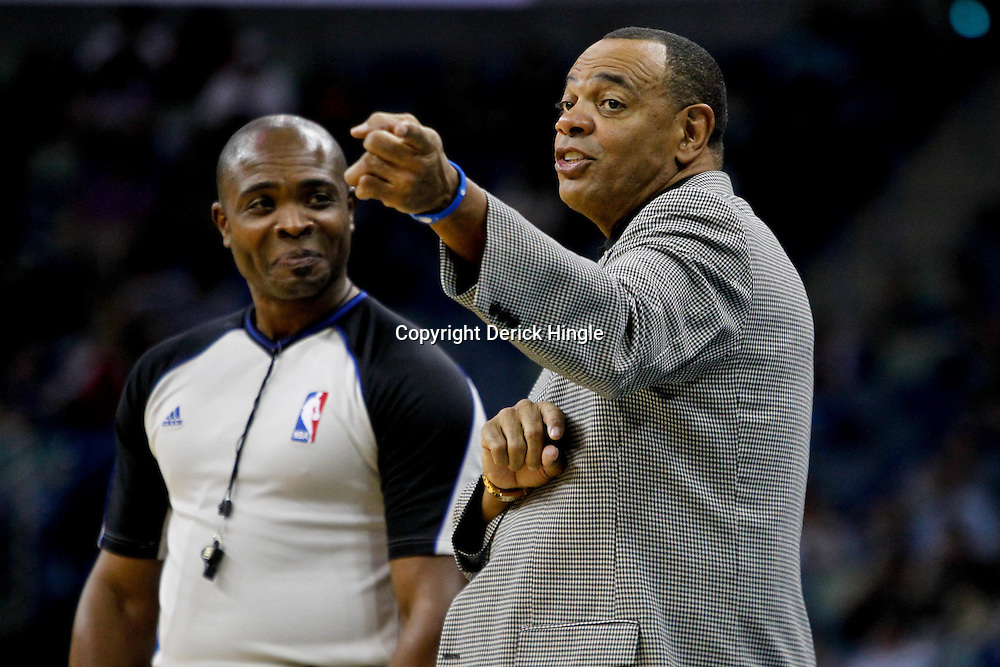 December 21, 2011; New Orleans, LA, USA; Memphis Grizzlies head coach Lionel Hollins talks with official Courtney Kirkland during the second half of a preseason game against the New Orleans Hornets at the New Orleans Arena. The Hornets defeated the Grizzlies 95-80.  Mandatory Credit: Derick E. Hingle-US PRESSWIRE