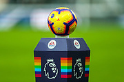 The Premier League football sits on the rainbow coloured pedestal ahead of the Premier League match between Newcastle United and West Ham United at St. James's Park, Newcastle, England on 1 December 2018.