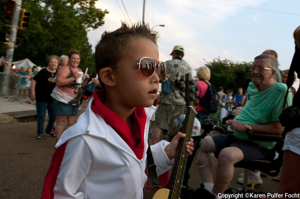 Kai Ballardin,5, and his mother traveled to Memphis from Scotland to be a part of Death Week at Graceland in Memphis on Saturday. Police say about 30,000 fans participated in the Candlelight Vigil at Elvis Presley's Memphis home, Graceland, according to Graceland officials. Fans lit candles, created shrines and sang Elvis songs before the gates opened. A ceremony began about 8:30 outside of the Graceland gates and many fans processed passed the grave of the King of Rock and Roll.