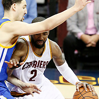 10 June 2016: Cleveland Cavaliers guard Kyrie Irving (2) drives past Golden State Warriors guard Klay Thompson (11) during the Golden State Warriors 108-97 victory over the Cleveland Cavaliers, during Game Four of the 2016 NBA Finals at the Quicken Loans Arena, Cleveland, Ohio, USA.