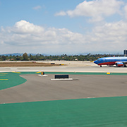 Airplane taking off at LAX. Los Angeles, California, USA.