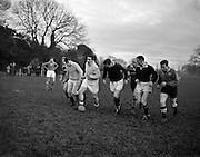 Irish Rugby Football Union, Ireland v Australia, Tour Match, Australian and Irish team practice in College Park, Dublin, Ireland, Tuesday 14th January, 1958,.14.1.1958, 1.14.1958,..Irish Team, ..P J Berkery, Wearing number 15 Irish jersey, Full back, Landsdowne Rugby Football Club, Dublin, Ireland, and, London Irish Rugby Football Club, Surrey, England, ..A J F O'Reilly, Wearing number 14 Irish jersey, Right Wing, Old Belvedere Rugby Football Club, Dublin, Ireland, ..N J Henderson, Wearing number 13 Irish jersey, Captain of the Irish team, Right centre, N.I.F.C, Rugby Football Club, Belfast, Northern Ireland, ..D Hewitt, Wearing number 12 Irish jersey, Left centre, Queens University Rugby Football Club, Belfast, Northern Ireland,. .A C Pedlow, Wearing number 11 Irish jersey, Left wing, C I Y M S Rugby Football Club, Belfast, Northern Ireland, ..J W Kyle, Wearing number 10 Irish jersey, Stand Off, N.I.F.C, Rugby Football Club, Belfast, Northern Ireland, ..A A Mulligan, Wearing number 9 Irish jersey, Scrum Half, Cambridge University Rugby Football Club, Cambridge, England, and, London Irish Rugby Football Club, Surrey, England, ..B G M Wood, Wearing number 1 Irish jersey, Forward, Garryowen Rugby Football Club, Limerick, Ireland, ..R Dawson, Wearing number 2 Irish jersey, Forward, Wanderers Rugby Football Club, Dublin, Ireland, ..P J O'Donoghue, Wearing  Number 3 Irish jersey, Forward, Bective Rangers Rugby Football Club, Dublin, Ireland,  ..W A Mulcahy, Wearing number 4 Irish jersey, Forward, University College Dublin Rugby Football Club, Dublin, Ireland,..J B Stevenson, Wearing number 5 Irish jersey, Forward, Instonians Rugby Football Club, Belfast, Northern Ireland,..J A Donaldson, Wearing number 6 Irish jersey, Forward, Collegians Rugby Football Club, Belfast, Northern Ireland,..J R Kavanagh, Wearing number 7 Irish jersey, Forward, Wanderers Rugby Football Club, Dublin, Ireland, ..N Murphy, Wearing number 8 Irish jersey, Forward, Cork Constitution Rugby Football C