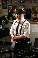 Staff Photo by Dan Henry / The Chattanooga Times Free Press- 3/30/15. Tim Warner, a fine art painter and tattoo artist at Main Line Ink, stands in his workspace on Monday, March 30, 2015.  <br /> <br /> For Chatter
