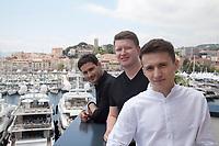 Actor Remzi Bilyalov, Director Nariman Aliev and actor Akthem Seitablaev at Evge (Homeward) film photo call at the 72nd Cannes Film Festival,  Thursday 23rd May 2019, Cannes, France. Photo credit: Doreen Kennedy