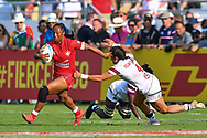 Charity Williams of Canada evades the tackle of Nicole Heavirland of USA <br /> <br /> Photographer Craig Thomas/Replay Images<br /> <br /> World Rugby HSBC World Sevens Series - Day 2 - Friday 6rd December 2019 - Sevens Stadium - Dubai<br /> <br /> World Copyright © Replay Images . All rights reserved. info@replayimages.co.uk - http://replayimages.co.uk