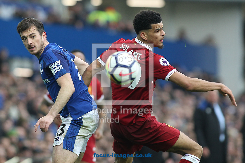 Leighton Baines of Everton and Dominic Solanke of Liverpool in action during the Premier League match at Goodison Park, Liverpool.<br /> Picture by Michael Sedgwick/Focus Images Ltd +44 7900 363072<br /> 07/04/2018