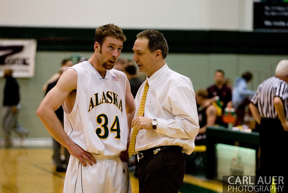 1/6/2006: Junior forward Carl Arts (34) of the UAA Seawolves talks over a play with head coach Rusty Osborne as Anchorage goes on to beat the visiting Central Washington Wildcats, 80-60 at the Wells Fargo Sports Complex on the campus of UAA.<br />