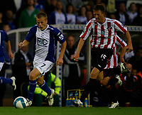 Photo: Steve Bond.<br />Birmingham City v Sunderland. The FA Barclays Premiership. 15/08/2007. Sebastian Larsson (L) goes outside Danny Collins (R)