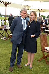 CHARLIE GORDON-WATSON and his wife KATE REARDON at the 2013 Cartier Queens Cup Polo at Guards Polo Club, Berkshire on 16th June 2013.