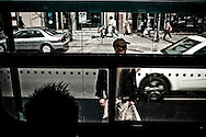 Chinese commuter at street car stop on Spadina Avenue, Toronto, Canada