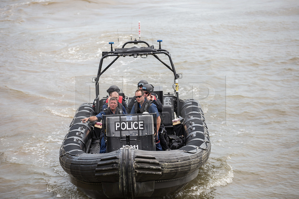 © Licensed to London News Pictures. 30/06/2015. London, UK. Armed officers travelling by boat seen with the O2 Arena. A joint exercise called 'Exercise Strong Tower' between the three emergency services continued today in the Wood Wharf area, near Canary Wharf.  Photo credit : James Gourley/LNP