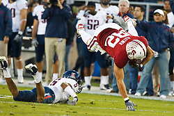 November 6, 2010; Stanford, CA, USA;  Stanford Cardinal tight end Coby Fleener (82) is tackled by Arizona Wildcats cornerback Shaquille Richardson (5) during the second quarter at Stanford Stadium.