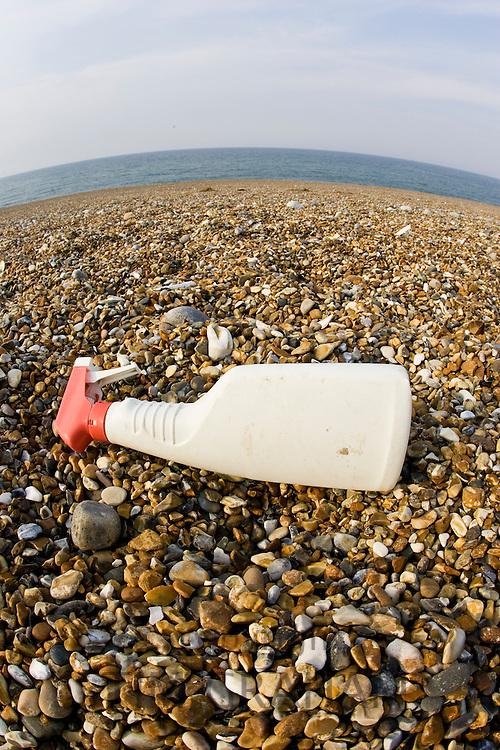 Plastic spray bottle discarded on Cley Beach, Norfolk, United Kingdom