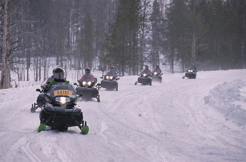 Yellowstone National Park, Snowmobiling in park, on road near Old Faithful.